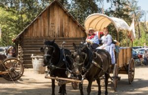 Couple in 1850s period dress in Coloma, CA for Coloma Gold Rush Live