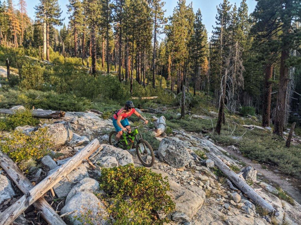 Woman mountain biking rocky trail in El Dorado County